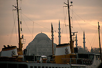 The Suleymaniye Mosque and a 1950s ferry boat still in use at Karakoy, Istanbul, Turkey