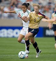 Lindsay Tarpley battles for the ball with Mexico's Maria de Jesus Castillo..International friendly, USA Women vs Mexico, Albuquerque, NM,.October 20, 2006.