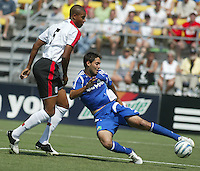 Major League Soccer's Clint Dempsey (right) takes a shot past Fulham FC's Zat Knight (left) during the MLS All Star game in Columbus, Ohio Saturday, July 30, 2005.