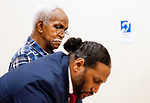 WATERBURY, CT 21_NEW_122017JS02-- Milton Gooch, 80, loons on as his attorney Thomas K. Mitchell-Hoffler writes down notes during his arraignment Wednesday at Waterbury Superior Court. Gooch is charged in connection with a fatal hit-and-run crash on December 12, in Waterbury, that killed 75-year-old Geraldine ÒGeriÓ LaPio. <br />Jim Shannon Republican-American