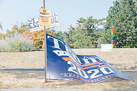 A large Trump 2020 is seen tied to a parking sign as the alt-right organization Super Happy Fun America demonstrates against facemasks, vaccines, and pandemic closures, and in support of the reelection of President Donald J. Trump near the residence of Massachusetts governor Charlie Baker in Swampscott, Massachusetts, on Sat., Sept. 26, 2020. Super Happy Fun America is most well known for organizing the Straight Pride Parade in Boston on August 31, 2019.
