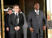 Ivorian president Alassane Ouattara(R) with former French president Nicolas Sarkozy(L) speaks at the presidential palace in Abidjan, on March 18, 2016.
