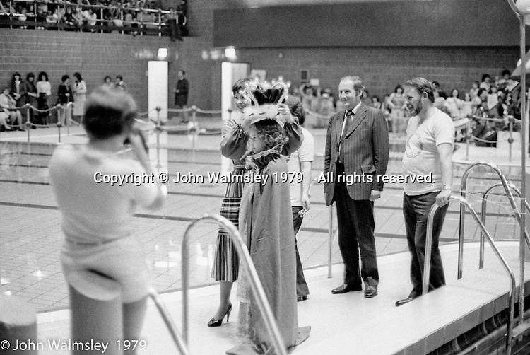 Crowning the Gala Queen, Festival & Gala Day, Wester Hailes, Scotland, 1979.  Ralph Wilson, Principal of the Wester Hailes Education Centre on the far left.  John Walmsley was Photographer in Residence at the Education Centre for three weeks in 1979.  The Education Centre was, at the time, Scotland's largest purpose built community High School open all day every day for all ages from primary to adults.  The town of Wester Hailes, a few miles to the south west of Edinburgh, was built in the early 1970s mostly of blocks of flats and high rises.