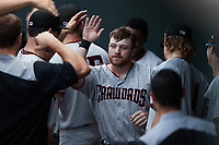 Blaine Crim (9) of the Hickory Crawdads is congratulated by teammates after hitting a home run against the Winston-Salem Dash at Truist Stadium on July 10, 2021 in Winston-Salem, North Carolina. (Brian Westerholt/Four Seam Images)