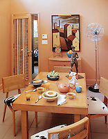 The breakfast room is painted a soothing coral pink and a door leads directly to the garage beyond
