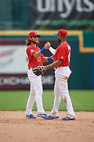 Buffalo Bisons shortstop Bo Bichette (13) shakes hands with second baseman Richard Urena (16) after an International League game against the Indianapolis Indians on June 20, 2019 at Sahlen Field in Buffalo, New York.  Buffalo defeated Indianapolis 11-8  (Mike Janes/Four Seam Images)