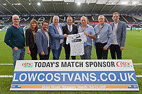 Lee Trundle (C) with match sponosrs Low Cost Vans during the Sky Bet Championship match between Swansea City and Leeds United at the Liberty Stadium, Swansea, Wales, UK. Tuesday 21 August 2018