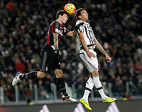 Calcio, Serie A: Juventus vs Milan. Torino, Juventus Stadium, 21 novembre 2015. <br /> AC Milan's Alessio Romagnoli, left, and Juventus' Mario Mandzukic jump for the ball during the Italian Serie A football match between Juventus and AC Milan at Turin's Juventus stadium, 21 November 2015. Juventus won 1-0.<br /> UPDATE IMAGES PRESS/Isabella Bonotto