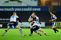 Alun Wyn Jones of Ospreys is tackled by Giulio Bisegni of Zebre during the Guinness Pro14 Round 10 match between the Ospreys and Zebre at the Liberty Stadium in Swansea, Wales, UK.  Friday 30 November 2018