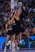Junior Levi collects a pass under pressure from Jane Watson (left) during the Cadbury Netball Series final between NZ Silver Ferns and NZ Men at the Fly Palmy Arena in Palmerston North, New Zealand on Saturday, 24 October 2020. Photo: Dave Lintott / lintottphoto.co.nz
