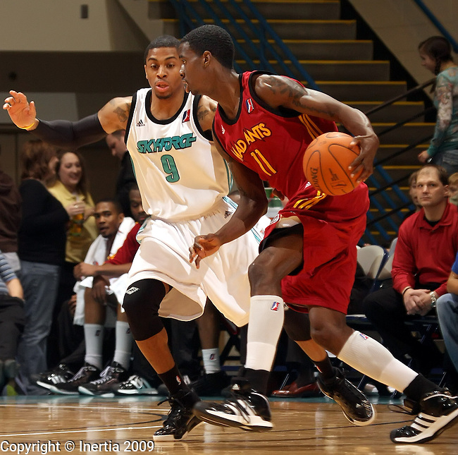 SIOUX FALLS, SD - JANUARY 15:  Dewitt Scott #11 of the Ft. Wayne Mad Ants tries to drive past Gary Ervin #9 of the Sioux Falls Skyforce in the first half of their game Friday night at the Arena. (Photo by Schyler Eggen/Inertia)