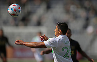 LOS ANGELES, CA - APRIL 17: Nick Lima #24 of Austin FC heads a ball during a game between Austin FC and Los Angeles FC at Banc of California Stadium on April 17, 2021 in Los Angeles, California.