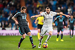Karim Benzema (r) of Real Madrid fights for the ball with Inigo Martinez Berridi of Real Sociedad during their La Liga match between Real Madrid and Real Sociedad at the Santiago Bernabeu Stadium on 29 January 2017 in Madrid, Spain. Photo by Diego Gonzalez Souto / Power Sport Images