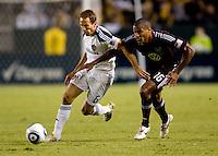 LA Galaxy midfielder Eddie Lewis attempts to move around DC United defender Jordan Graye. The LA Galaxy defeated DC United 2-1at Home Depot Center stadium in Carson, California on Saturday September 18, 2010.