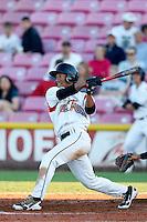 Randy Ortiz #14 of the Salem-Keizer Volcanoes bats against the Tri-City Dust Devils at Volcanoes Stadium on July 27, 2013 in Keizer, Oregon. Tri-City defeated Salem-Keizer, 5-4. (Larry Goren/Four Seam Images)