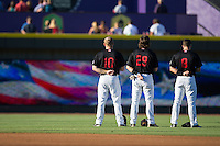(L-R) Mason Robbins (10), Hunter Jones (29), and Michael Suiter (8) stand for the National Anthem prior to the game against the Salem Red Sox at BB&T Ballpark on June 16, 2016 in Winston-Salem, North Carolina.  The Dash defeated the Red Sox 7-1.  (Brian Westerholt/Four Seam Images)