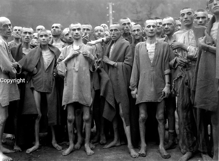 """May 7, 1945. - Starved prisoners, nearly dead from hunger, pose in concentration camp in Ebensee, Austria. The camp was reputedly used for """"scientific"""" experiments. It was liberated by the 80th Division. May 7, 1945. Lt. A. E. Samuelson. (Army)"""