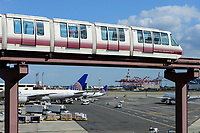 USA, New York City, Newark Airport, skytrain, shuttle train and Boeing aircraft of United Airlines at gate