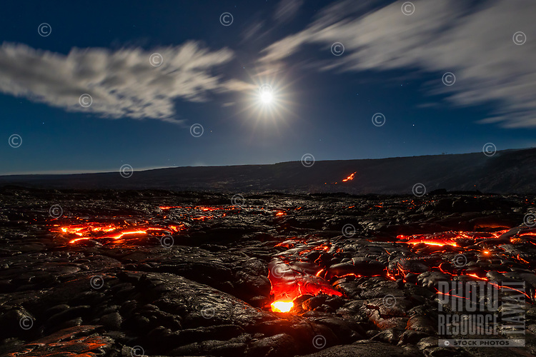 A super moon sets over lava fields at Pulama Pali (part of Holei Pali), Hawai'i Volcanoes National Park, Hawai'i Island, early New Year's Day 2018.