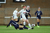 CHAPEL HILL, NC - NOVEMBER 16: A.B. Hawkins #8 of Belmont University is stripped of the ball by Aleigh Gambone #16 and Alexis Strickland #12 of the University of North Carolina during a game between Belmont and North Carolina at UNC Soccer and Lacrosse Stadium on November 16, 2019 in Chapel Hill, North Carolina.