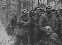BNPS.co.uk (01202) 558833. <br /> Pic: Bosleys/BNPS<br /> <br /> Pictured: SAS troops around the campfire before crossing the Rhine. <br /> <br /> Never before seen photos taken by a fishmonger turned SAS hero behind enemy lines in World War Two have come to light 76 years on.<br /> <br /> Sergeant Samuel Rushworth, of the 2nd Special Air Service, was dropped into occupied France two days before D-Day in June 1944.<br /> <br /> They were tasked with disrupting German reinforcements dispatched to Normandy following the Allied landings.
