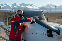 Student pilot Mark Tikalsky prepares a Cessna Skyhawk for a training flight at UAA's Aviation Technology campus on Merrill Field.