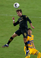 22nd December 2020, Orlando, Florida, USA;  LAFC Daniel Musovski (16) heads the ball during the Concacaf Champions League Final between the LAFC and Tigres on December 22, 2020 at Explorer Stadium in Orlando, FL.