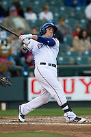Round Rock Express first baseman Chris McGuiness #21 follows through on his swing against the Omaha Storm Chasers in the Pacific Coast League baseball game on April 4, 2013 at the Dell Diamond in Round Rock, Texas. Round Rock defeated Omaha in their season opener 3-1. (Andrew Woolley/Four Seam Images).