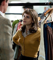 EMMA IN NEW LOCKS, STOCKS AND.....<br /> <br /> Emma Watson looks frumpy in new Marilyn Monroe film<br /> In her first role since Harry Potter, Emma Watson plays a wardrobe assistant in the biopic My Week with Marilyn, ditching her trademark short hair for a curly brunette wig.<br /> The film is based on the diary of Colin Clark who was Laurence Olivier's assistant and who looked after Marilyn Monroe while she was filming in London.<br /> <br /> The Harry Potter star will be playing the part of Lucy, an assistant in the wardrobe department at Pinewood Studios who Clark (played by Eddie Redmayne) flirted with as much as possible in between takes.<br /> <br /> In the diary he describes Lucy as: 'One of the prettiest little girls I have ever seen in my life... slim as a wand, curly brown hair, huge brown eyes and a wide cheeky grin' - Emma Watson down to a T then.<br /> <br /> Picture shows: Emma in a scene from the film talks to a customer  surrounded by her stocks.