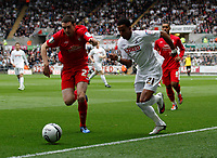 Pictured: Scott Sinclair of Swansea goes around Brendan Moloney on the wing<br /> Swansea City FC (white) V Nottingham Forest (red) Championship play off semi final, second leg. Liberty Stadium Swansea 16/05/11<br /> Picture by: Ben Wyeth  / Athena Picture Agency<br /> info@athena-pictures.com