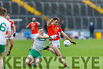 Ballydonoghue's Jason Foley makes a valiant effort in stopping Brosna's Timmy Finnegan scoring effort in the Premier Junior Football Championship Semi-Final