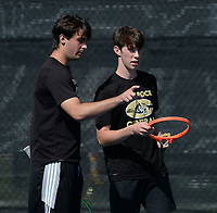 Little Rock Centrals' Alex Wells (right) and doubles partner Stefan Tudoreanu speak Tuesday, Oct. 12, 2021, during the 6A state tennis finals at Memorial Park in Bentonville. Visit nwaonline.com/211013Daily/ for today's photo gallery.<br /> (NWA Democrat-Gazette/Andy Shupe)