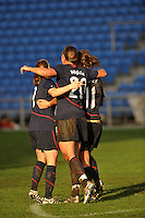 Heather O'Reilly (left), Abby Wambach (center, #20) and Lauren Cheney (right, #11) celebrate Cheney's game winning goal. The USA captured the 2010 Algarve Cup title by defeating Germany 3-2, at Estadio Algarve on March 3, 2010.