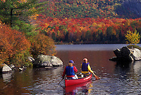 canoeing, autumn, canoe, Vermont, VT, Mother and daughter paddle a red canoe on Marshfield Pond in the fall.