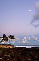 Moon rises over Poipu as the earth shadow turns the horizon to blues and purples.