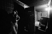 """Denver, Colorado<br /> USA<br /> May 9, 1983<br /> <br /> Back stage with the Ramones lead guitarist: Johnny Ramone.<br /> <br /> The Ramones were an American rock band that formed in Forest Hills, Queens, New York in 1974, often cited as the first punk rock group. Despite achieving only limited commercial success, the band was a major influence on the punk rock movement both in the United States and the United Kingdom.<br /> <br /> All of the band members adopted pseudonyms ending with the surname """"Ramone"""", though none of them were actually related. They performed 2,263 concerts, touring virtually nonstop for 22 years. In 1996, after a tour with the Lollapalooza music festival, the band played a farewell show and disbanded.<br /> <br /> By a little more than eight years after the breakup, the band's three founding members--lead singer Joey Ramone, guitarist Johnny Ramone, and bassist Dee Dee Ramone--had all died."""