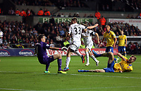 Saturday 28 September 2013<br /> Pictured: Ben Davies of Swansea (C) scores a goal, against Per Mertesacker (R) and goalkeeper Wojciech Szczesny (L) of Arsenal (R).<br /> Re: Barclay's Premier League, Swansea City FC v Arsenal at the Liberty Stadium, south Wales.