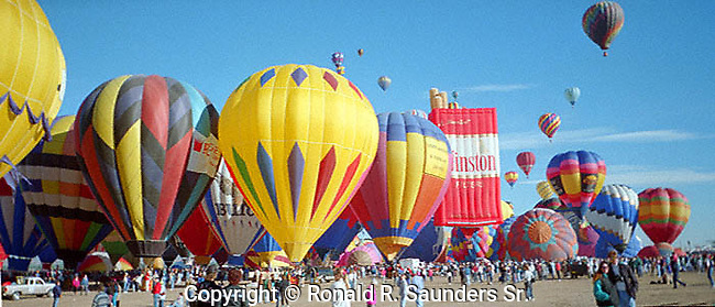 INFLATED, COLORFUL HOT AIR BALLOONS on GROUND at the ANNUAL ALBUQUERQUE BALLOON  FIESTA<br /> (1)