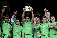 Australian captain Ed Jenkins (centre) holds up the Plate after beating England in the final during the iRB Marriott London Sevens at Twickenham on Sunday 13th May 2012 (Photo by Rob Munro)