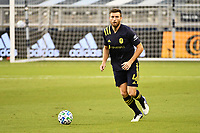KANSAS CITY, KS - OCTOBER 11: Dave Romney #4 Nashville SC with the ball during a game between Nashville SC and Sporting Kansas City at Children's Mercy Park on October 11, 2020 in Kansas City, Kansas.
