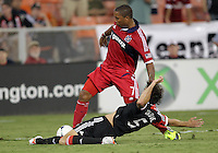 WASHINGTON, DC. - AUGUST 22, 2012:  Dejan Jakovic (5) of DC United slides the ball away from  Sherjill McDonald (7) of the Chicago Fire during an MLS match at RFK Stadium, in Washington DC,  on August 22. United won 4-2.