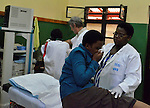 A Belgian doctor from the group DDK supervises and endoscopy at Gisenyi Community Hospital in northwest Rwanda..