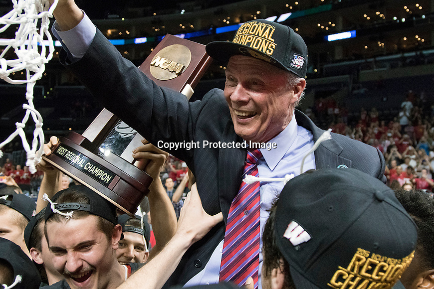 Wisconsin Badgers Head Coach Bo Ryan celebrates with his team after a college basketball Elite 8 West Regional game in the NCAA Tournament against the Arizona Wildcats Thursday, March 28, 2015, in Los Angeles.The Badgers won 85-78. (Photo by David Stluka)
