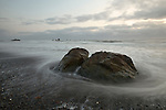 Waves weave around rocks at Ruby Beach in Olympic National Park, Washington, USA