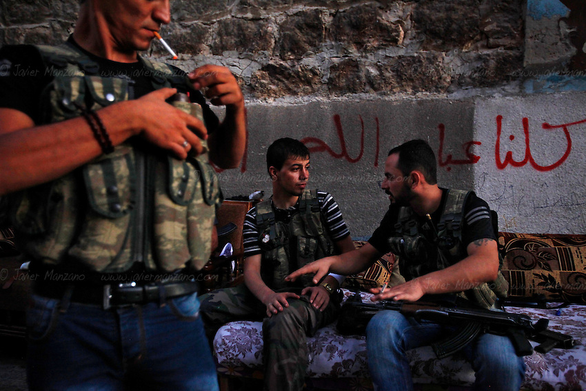 Free Syria Army soldiers relax at their base in Amariya after concluding a military operation in Aleppo.