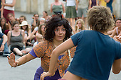 Young revellers give an impromptu freestyle dance performance in the main village street during the 31st International Festival of Luthiers and Maitres Sonneurs, in Saint Chartier, France.