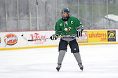 Notre Dame Fighting Irish of Batavia defensemen Dylan Cory (21) during a varsity ice hockey game against the Brockport Blue Devils during the Section V Rivalry portion of the Frozen Frontier outdoor hockey event at Frontier Field on December 22, 2013 in Rochester, New York.  (Copyright Mike Janes Photography)