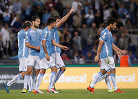 Calcio, Serie A: Lazio vs Frosinone. Roma, stadio Olimpico, 4 ottobre 2015.<br /> Lazio's Filip Djordjevic, second from right, celebrates with teammates after scoring during the Italian Serie A football match between Lazio and Frosinone at Rome's Olympic stadium, 4 October 2015.<br /> UPDATE IMAGES PRESS/Isabella Bonotto