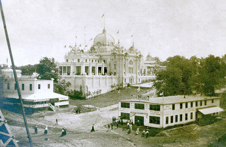 St Louis MO:   View of the State of Illinois building (center), the Lincoln Cafe (left), and a barbeque restaurant (right) from the Ferris Wheel.  This is one of the prints that he hand-colored to provide a better feel for the event.