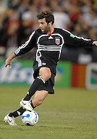 DC United midfielder Ben Olsen (14) dribbles the ball during the game. The Chicago Fire defeated DC United 3-2, Sunday, October 15, 2006, at RFK Stadium.